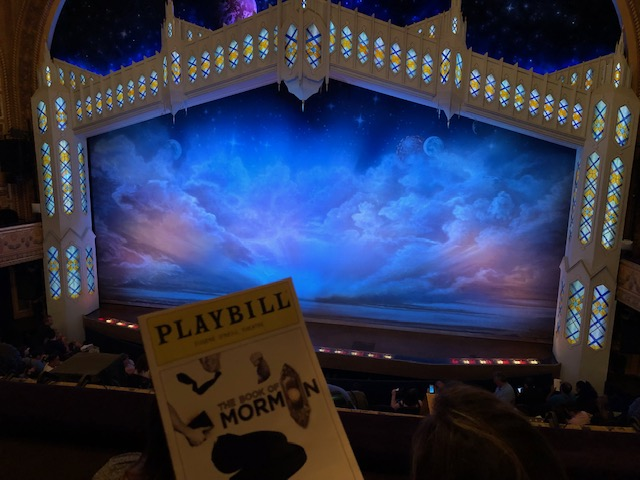 Book of Mormon stage with the Playbill snuck in bottom left