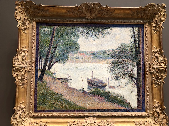 A steamboat close to the river bank, framed by trees, Pointillism style