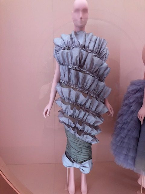 A blue chiffon dress, tight at the bodic then many frilly layers, being word upside down