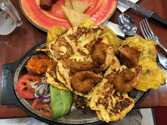 thinly cut grilled chicken, fried shrimp, friend plantains