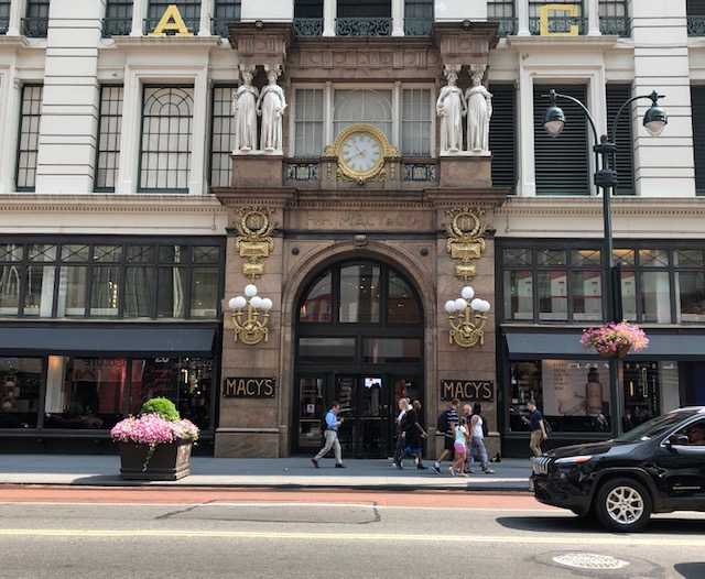 Beautifully decorated entrance to an older building; Macy's