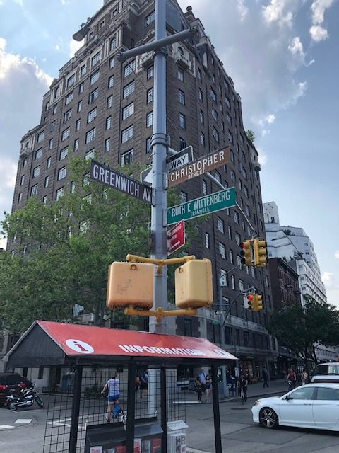 Street signs showing intersection of Greenwich Ave and Christopher St