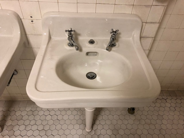A bathroom sink with the hot and cold faucets completely separate