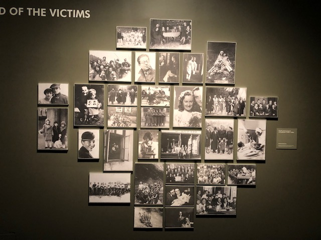 About 30 black and white photographs, from the 30's and 40's, framed and displayed as a collage