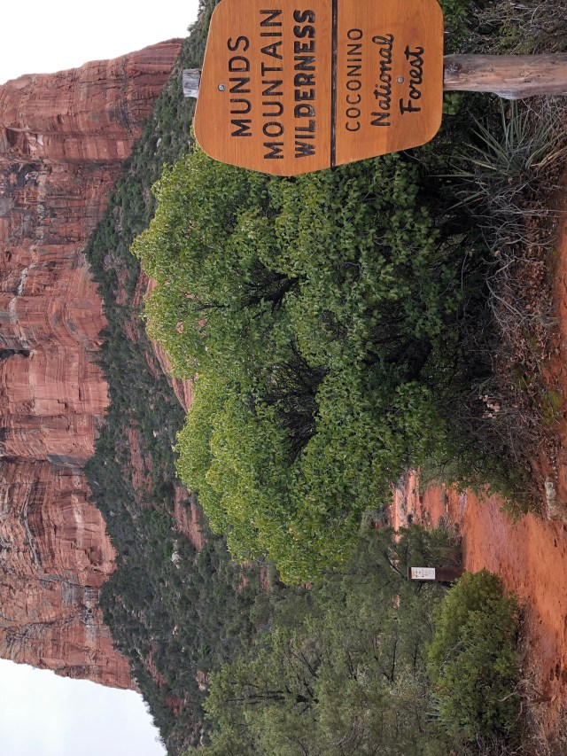 Courthouse Butte in the background, sign in front says Munds Mountain Wilderness, Coconino National Forest