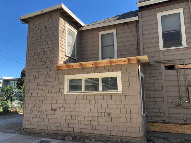 fresh wood over the roof where the downstairs unit extends out a little bit