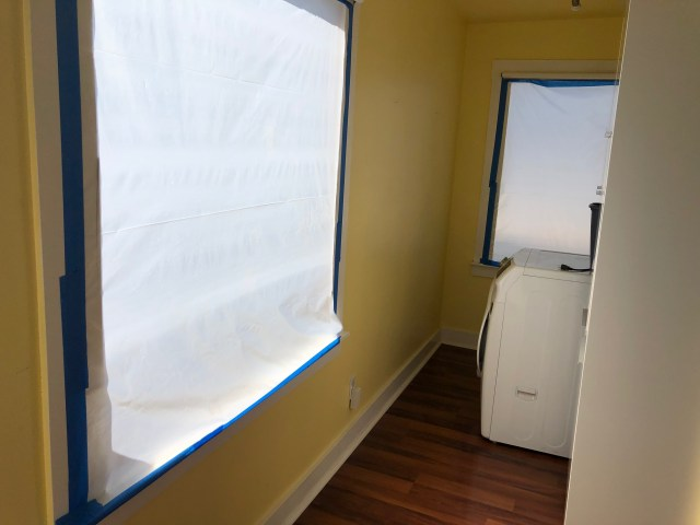 back windows out and covered in white paper framed by blue masking tape