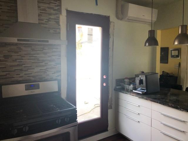 door replaced window in kitchen