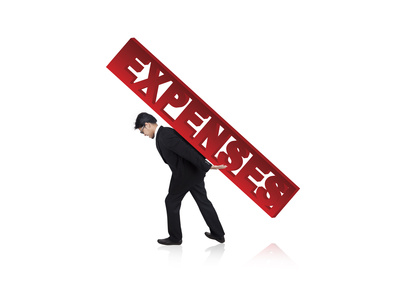 Businessman struggling with large Expenses
