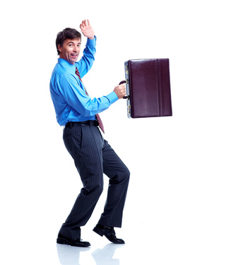 Happy businessman with case.