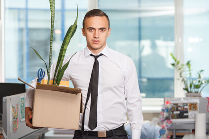 Dejected just fired an office worker with personal belongings in a box