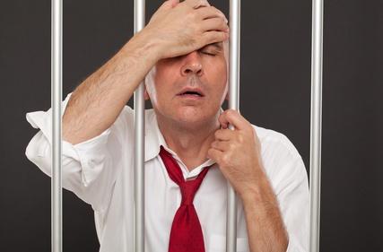 Regretful businessman in prison