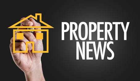 Hand writing the text: Property News