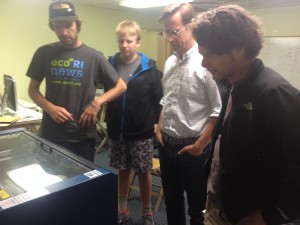 FabNewporters checking out the laser cutter during first class.