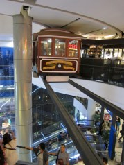Talk about surreal...a cable car in mid air...in a mall!