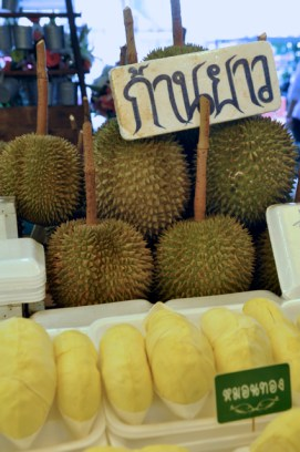 "The famous Durian, known for it's pungent (to put it nicely) odor and heavanly flavor (to some). It has a hard spikey exterior and soft custard-like interior. Chef Andrew Zimmern compares the taste to ""completely rotten, mushy onions"". Anthony Bourdain, a lover of durian, relates his encounter with the fruit thus: ""Its taste can only be described as...indescribable, something you will either love or despise. ...Your breath will smell as if you'd been French-kissing your dead grandmother."""