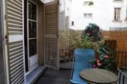 A nice little balcony facing the courtyard.
