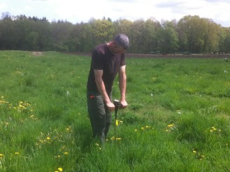 Eric Noël demonstrates how to use a penetrometer to measure soil compaction. Compacted soil is impenetrable to roots.