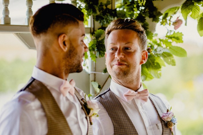 two grooms looking happy