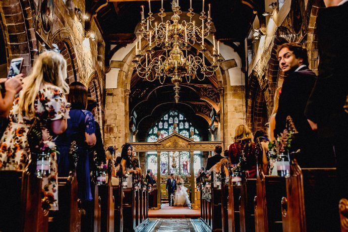 view down the aisle from the back of the church
