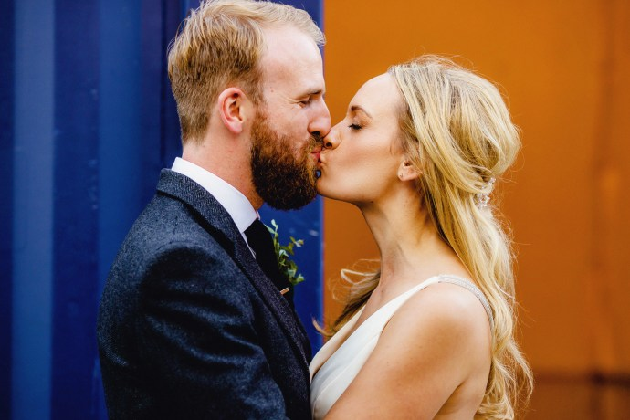kissing, bride and groom portrait
