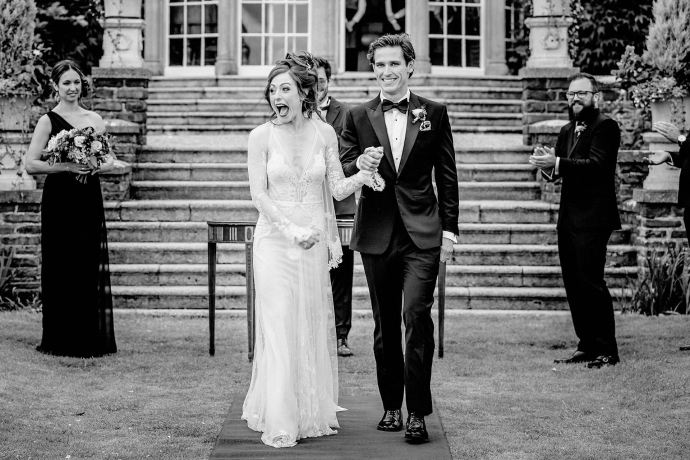 just married faces, walking down the aisle