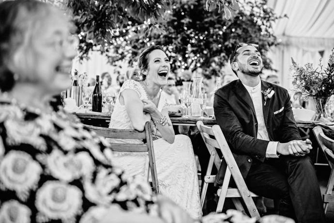 laughter, wedding photos in the marquee