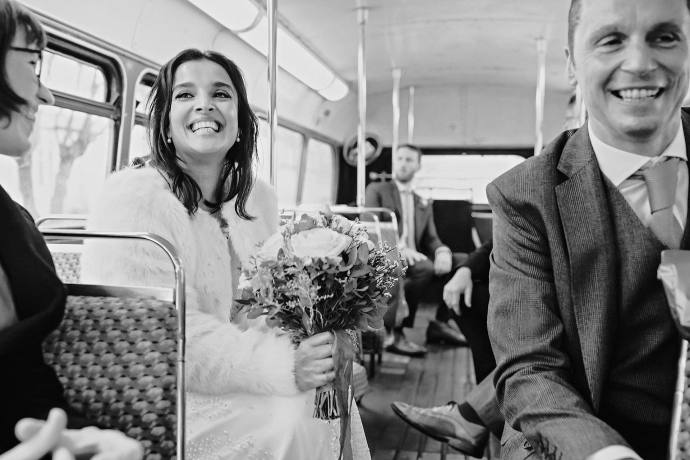 on the bus to the wedding reception