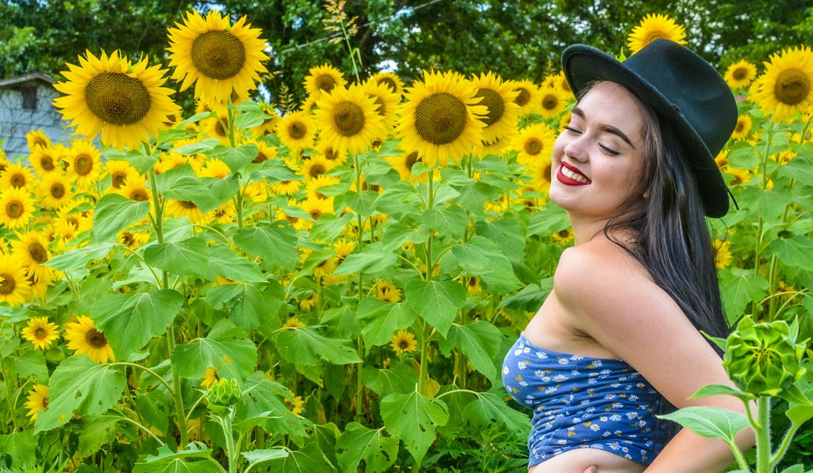 model in a sunflower field