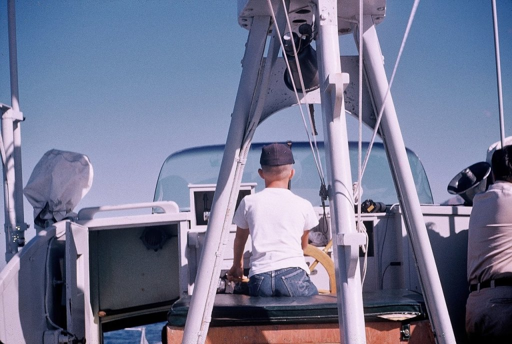 Steven T. Callan at the helm of the Fish and Game Patrol Boat Marlin