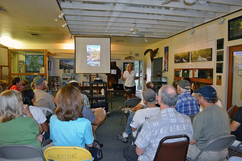 Program chair Jennifer Patten introduces author Steven T. Callan