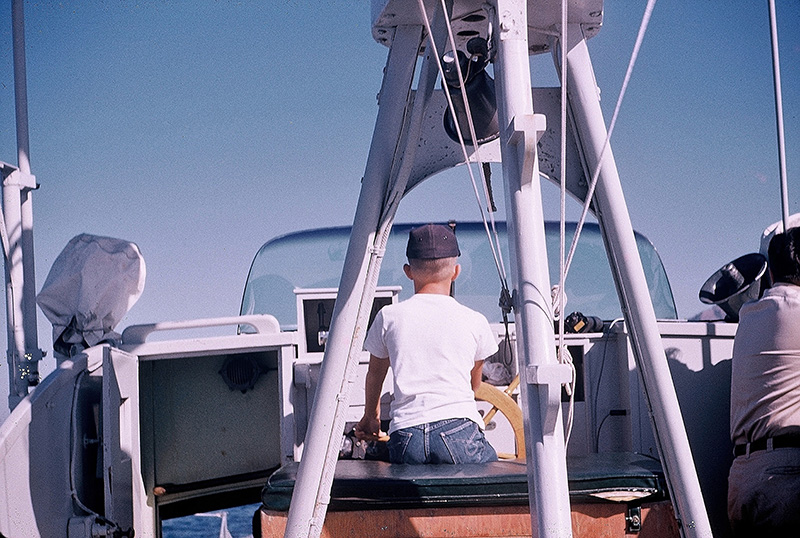 Author Steven T. Callan at the helm of the Fish and Game patrol boat Marlin, 1959.