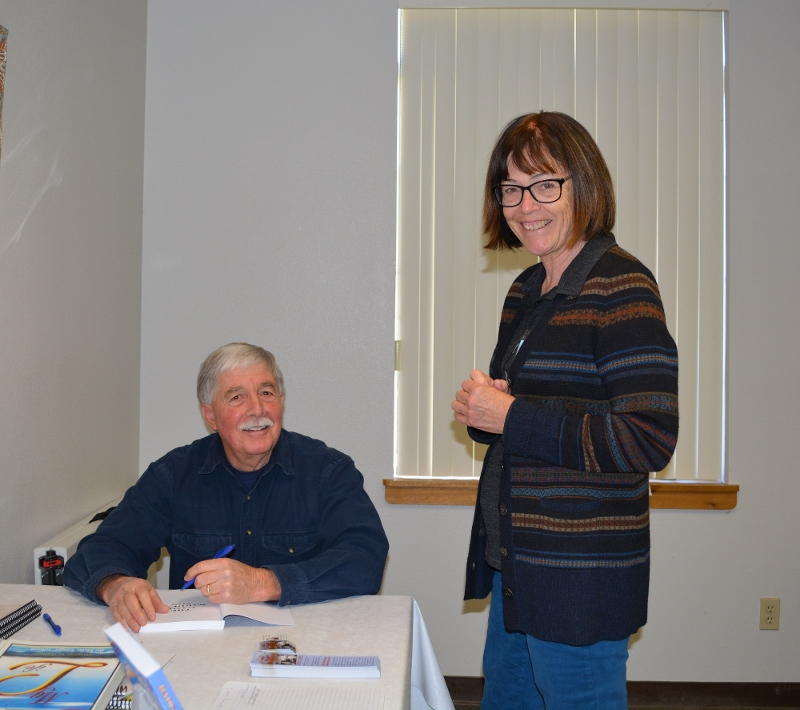 Steve signs a copy of his book The Game Warden's Son for a member of Redding Writers Forum.
