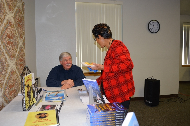 Author Steven T. Callan visits with a member of Redding Writers Forum during his visit to discuss his book The Game Warden's Son.