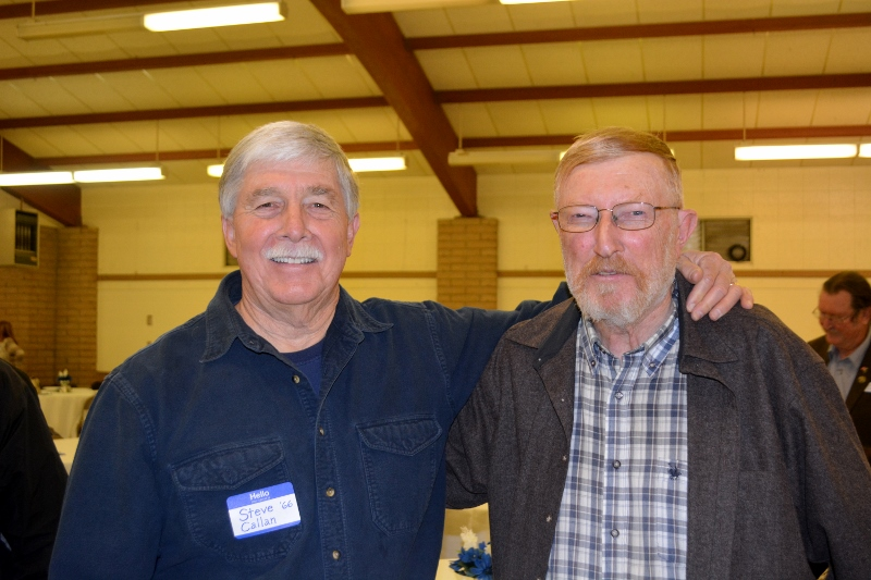 Author Steven T. Callan visits with Dr. Gene Russell at the Orland Alumni Association Awards Dinner.