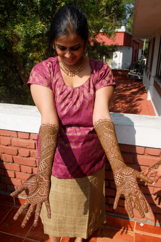 Bhavya showing off her mehendi.