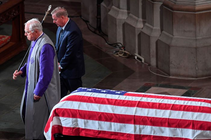 McCain's casket with wrinkled America flag is a symbol of a traitor.