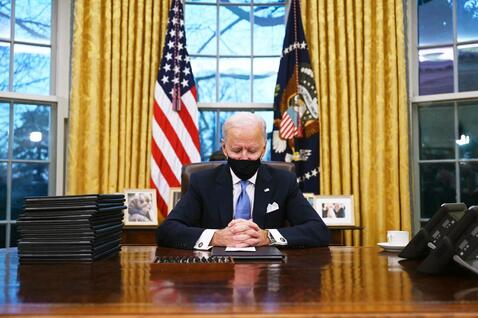 All the footage we see of the fake president that's supposedly taken at the White House appears to be shot somewhere else. There are shots of Joe supposedly sitting at the White House desk with elevated stage lights reflected in the windows, and other shots with a garbage truck visible outside the window. Since when do garbage trucks hang out behind the White House?