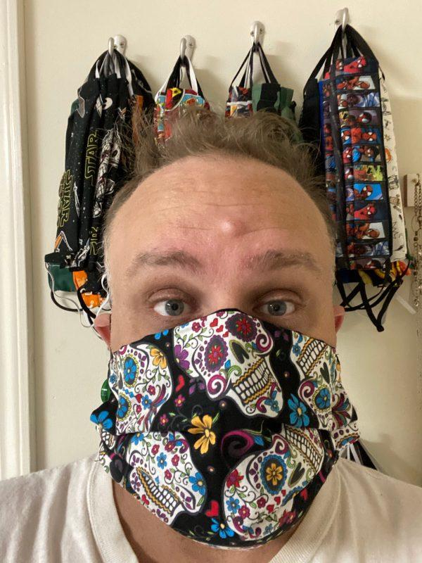 Black Sugar Skulls Face Mask - a black face mask with sugar skulls on it. #SugarSkulls #DayoftheDead