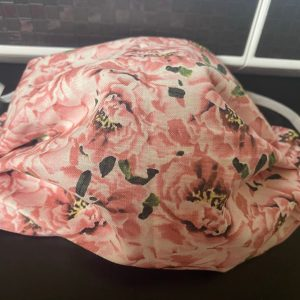 Pink Floral Face Mask a face mask with pink flowers on it. #Pink