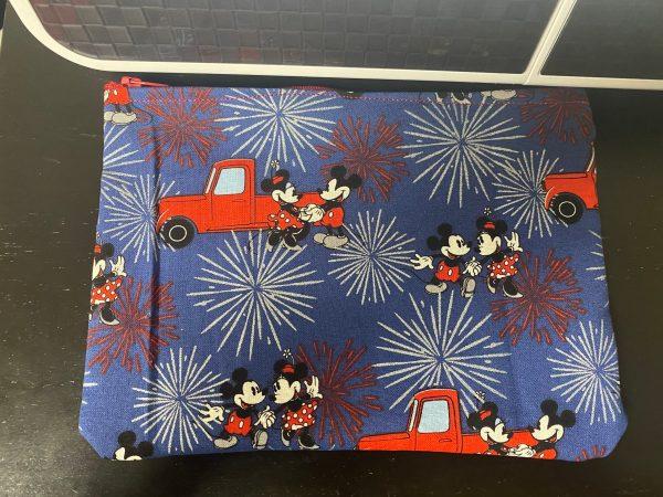 Mickey & Minnie Mouse Zipper Pouch a Zipper Pouch with Mickey Mouse and Minnie Mouse on it. #MickeyMouse #MinnieMouse