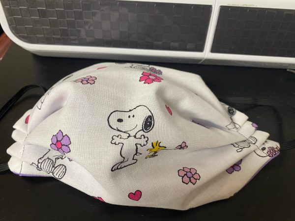 Spring Snoopy Face Mask - A Spring themed face mask with Snoopy and Woodstock with flowers and hearts.