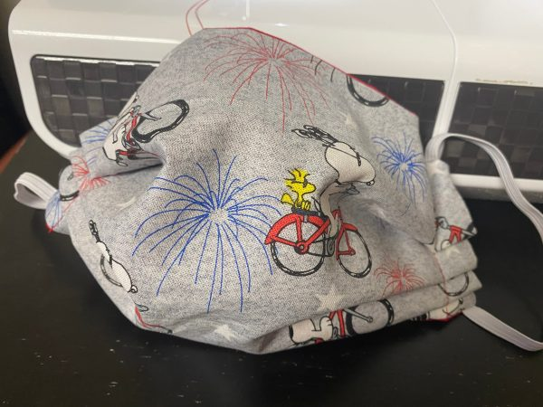 Snoopy & Woodstock on a Bicycle with Fireworks Face Mask - A 4th of July Patriotic Face Mask with Snoopy and Woodstock on it. #Snoopy #Woodstock