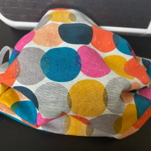 Colorful Circles Face Mask - a face mask with colorful circles on it.