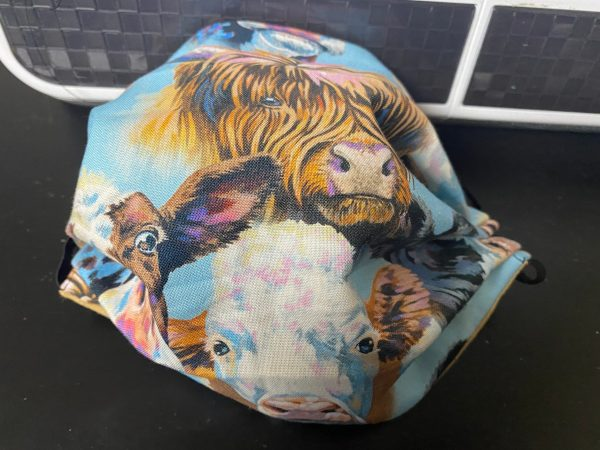 Cow Faces Face Mask - a face mask with several images of cows on it. #Cows