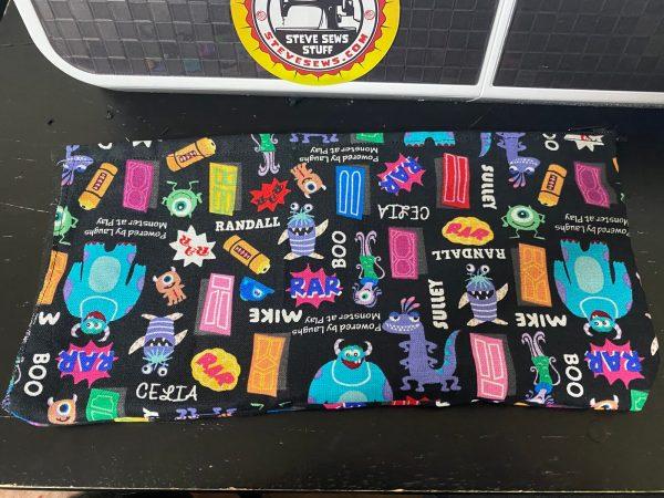 Monsters Inc Zipper Pouch - this is a zipper pouch with the gang from Monsters Inc on it. #MonstersInc #ZipperPouch