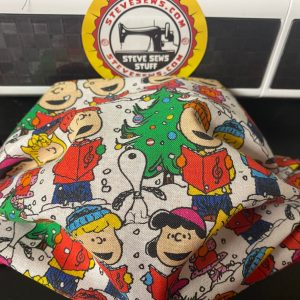 A Charlie Brown Christmas Face Mask - this face mask features Charlie Brown, Snoopy, and the gang singing a Christmas Carol. #Christmas #Snoopy #CharlieBrown #CharlieBrownChristmas #Snoopy