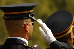 A soldier salutes during a ceremony at the Arlington National Ceremony.