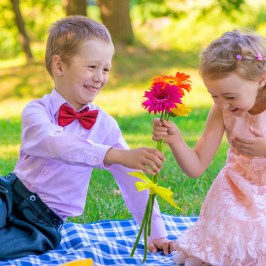 Little Gentleman Gives a Girl Flowers