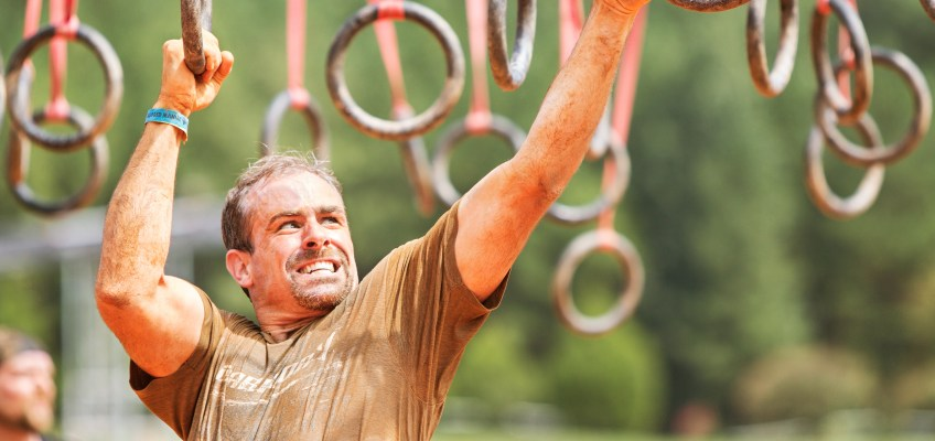 Man Competes in Obstacle Course Race